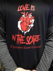 LOVE IS THE SCARE T SHIRTS image